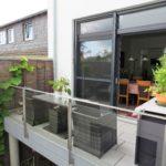 Balkon mit Korbsesseln